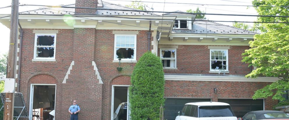 Crime scene photo shows the exterior of the Savopoulos residence after the fire.