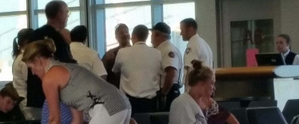 PHOTO: EMS workers congregate at the airport in Tulsa, Oklahoma, on July 9, 2016, after a Delta airlines flight was diverted there after several passengers became ill.