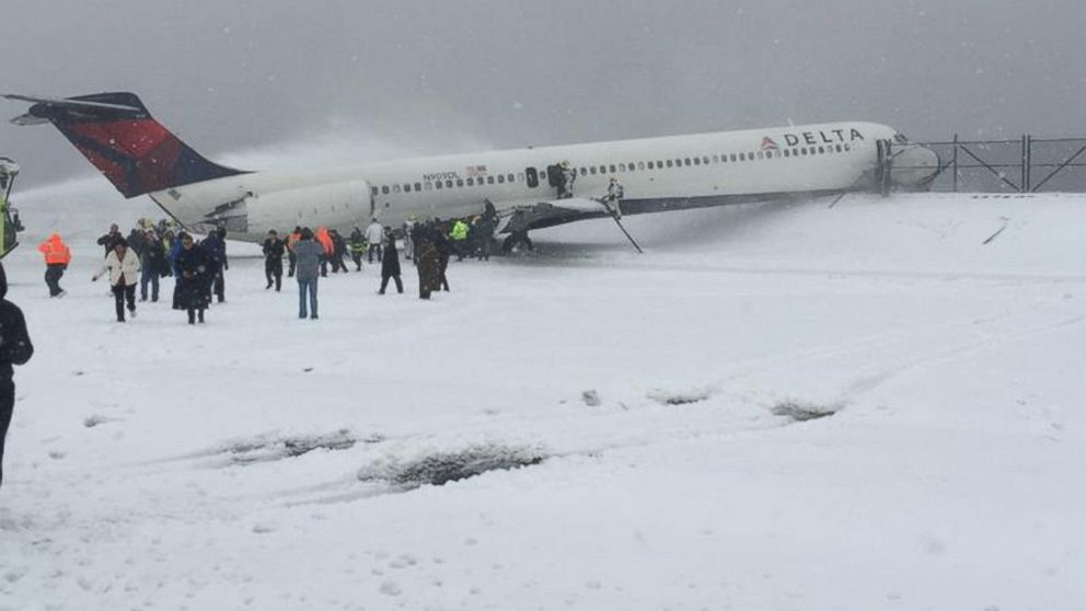 A photo posted to Twitter shows passengers disembarking from a Delta plane the slid off the runway at Laguardia Airport in New York, March 5, 2015.