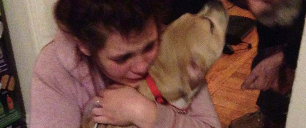 PHOTO: ACarla Daniel?s daughter Ashleigh tears up as she is reunited with her pup, Miyah who was stolen by a man who broke into her house.