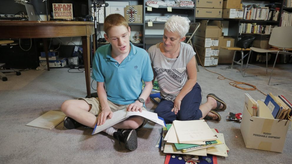 Christopher Duffley with his former Para Teacher Lisa Hanel in his home in Manchester, NH. July 26, 2016.