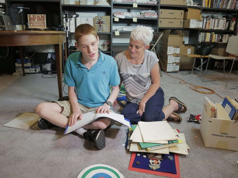 PHOTO: Christopher Duffley with his former Para Teacher Lisa Hanel in his home in Manchester, NH. July 26, 2016.