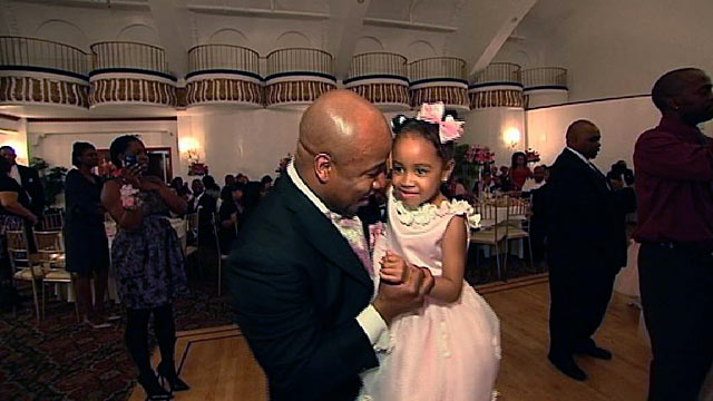 PHOTO: Seen here is a Father bonding with his daughter at a dance in In Harlems Alhambra Ballroom.