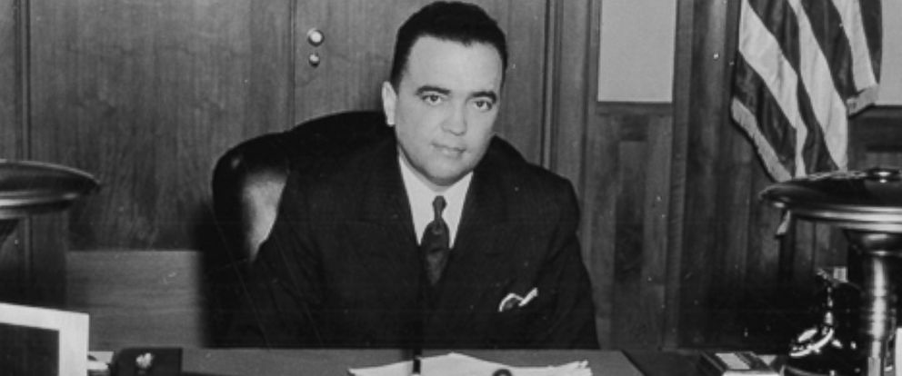 PHOTO: J. Edgar Hoover sits at his desk, circa 1937.