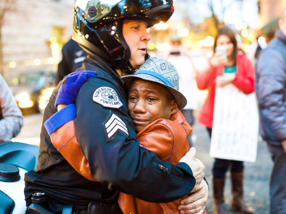 PHOTO: Devonte Hart hugs a cop in Portland, Ore., Nov. 25, 2014, in a photo that went viral. Hart has been reported missing following the death of his parents in a car crash.