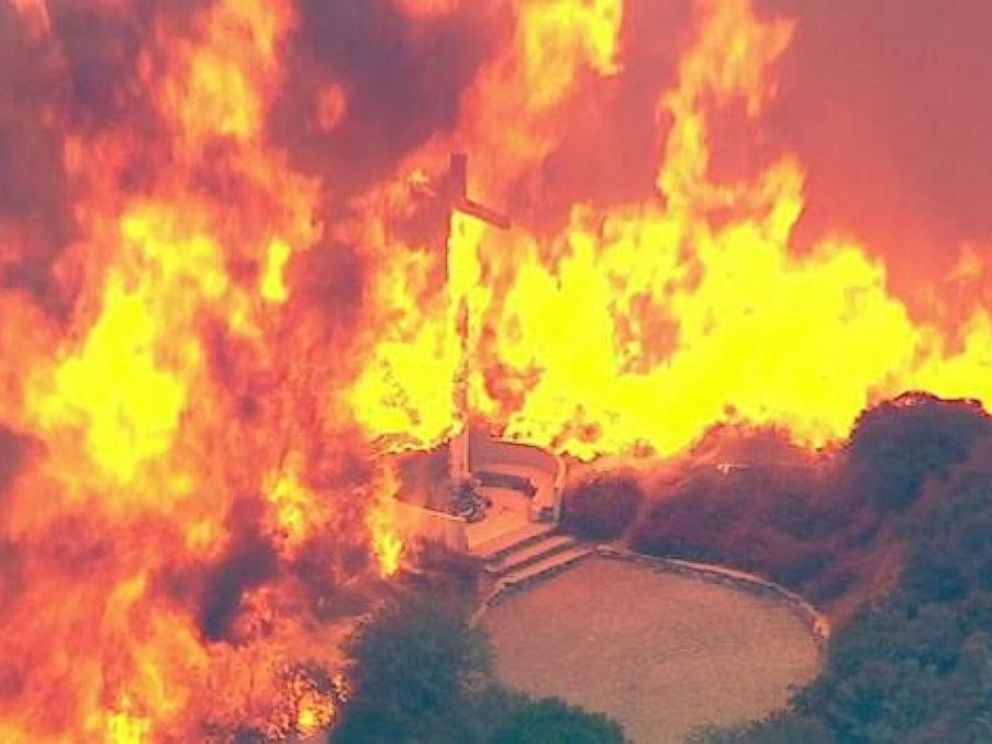 PHOTO: A cross burns in the Blue Cut Fire in the San Bernardino National Forest above Devore on Tuesday, Aug. 16, 2016.