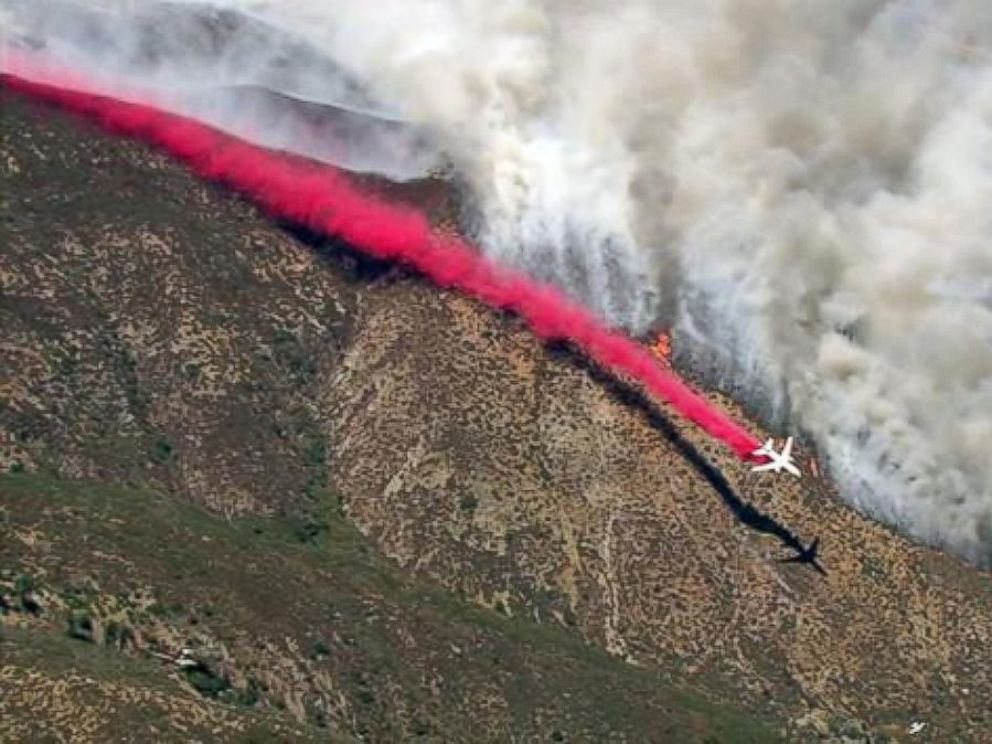 PHOTO: A plane drops fire retardant while battling the Blue Cut Fire in the San Bernardino National Forest on Tuesday, Aug. 16, 2016.