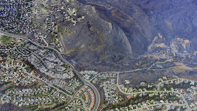 PHOTO: An aerial view of the Waldo Canyon fire in Colorado Springs shows the destructive path of the fire, June 27, 2012.