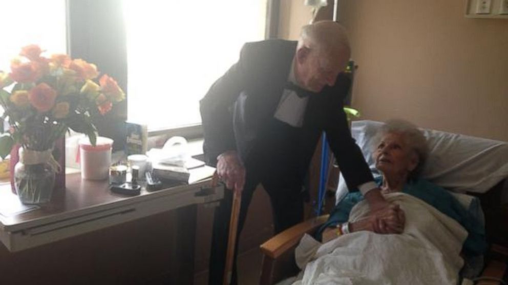 """On their 57th anniversary, James """"Jim"""" Russell showed up to his wife Elinor's hospital room wearing a tuxedo and carrying flowers and chocolate."""