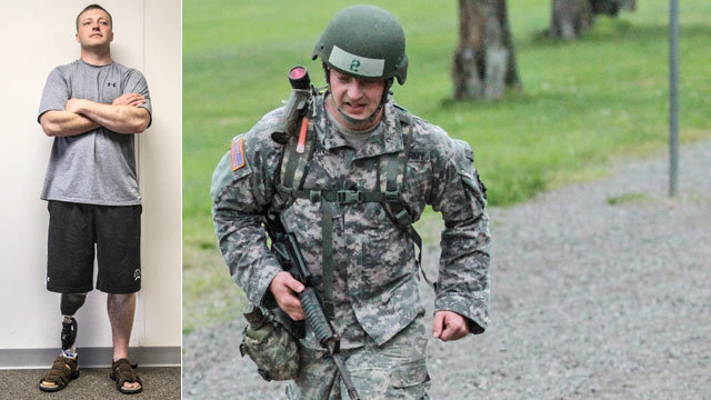 PHOTO: Army Sgt. 1st Class Greg Robinson, an amputee with the 101st Airborne Division graduated from air assault school on April 29, 2013.