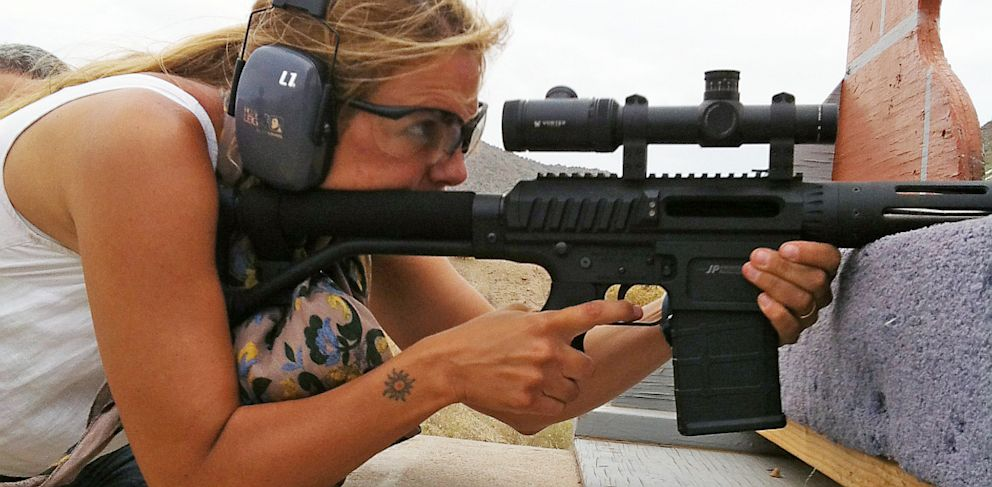 PHOTO: Woman firing rifle at gun range