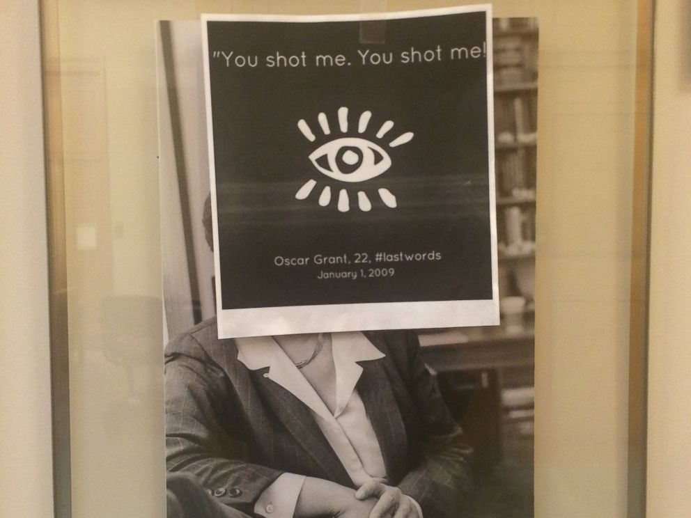 PHOTO: A piece of a paper posted on a professors portrait in the halls of Harvard Law School, Cambridge, Mass., that reads You shot me. You shot.