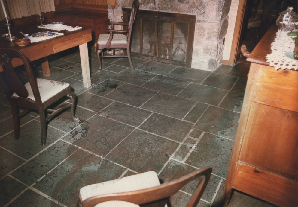Police photos shows blood on the dining room floor after the Haysom murders.