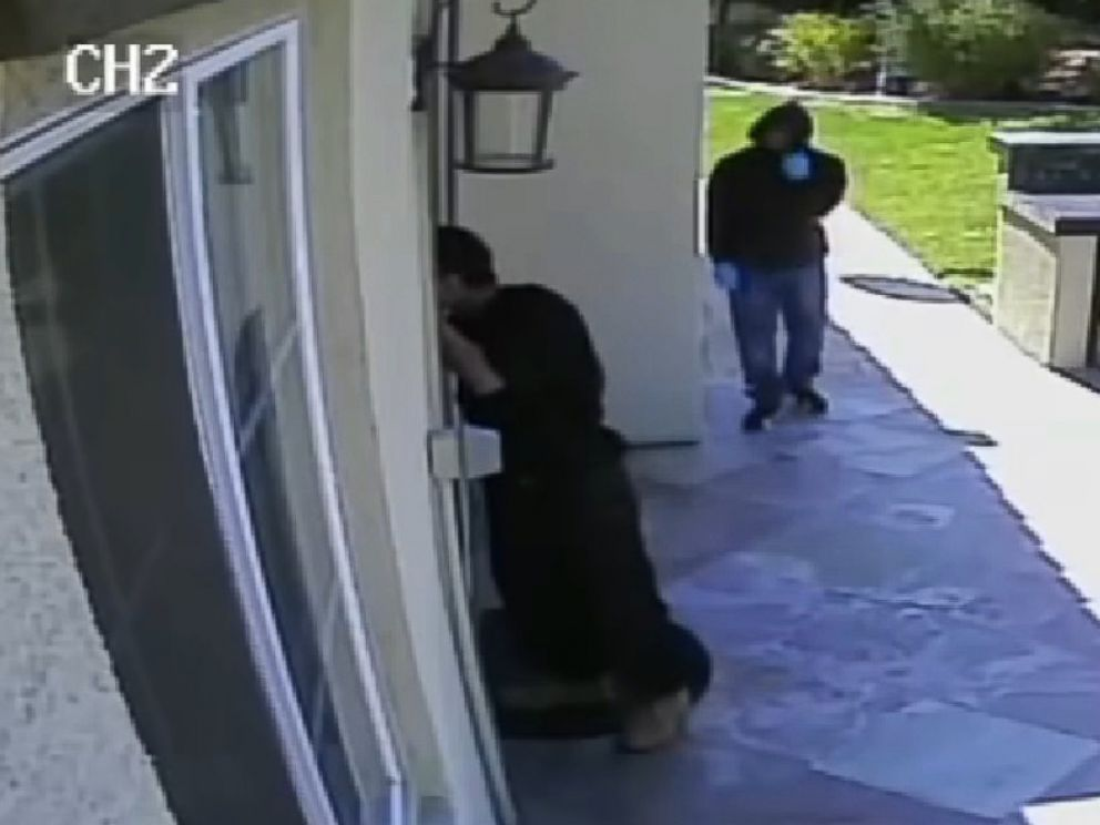 Security Footage Shows 2 Men Holding Knives Breaking Into
