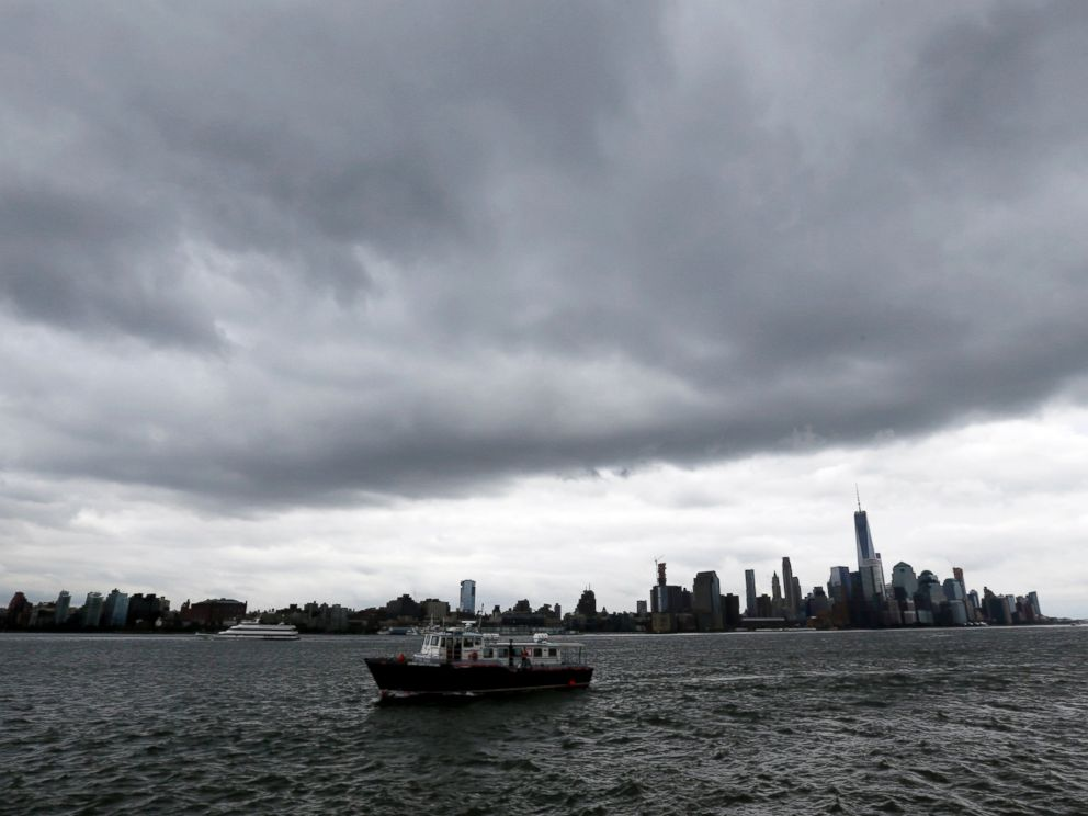 PHOTO: A boat passes Pier A Park on the Hudson River with the New York skyline in the background on Wednesday, Sept. 30, 2015, in Hoboken, N.J. Officials are taking precautions for the rest of the week as forecasters closely follow Hurricane Joaquin.