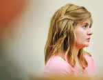 PHOTO Justine Winter wipes her eyes June 29, 2010, as she cries during the beginning of the hearing to determine whether she will be tried as a juvenile or an adult