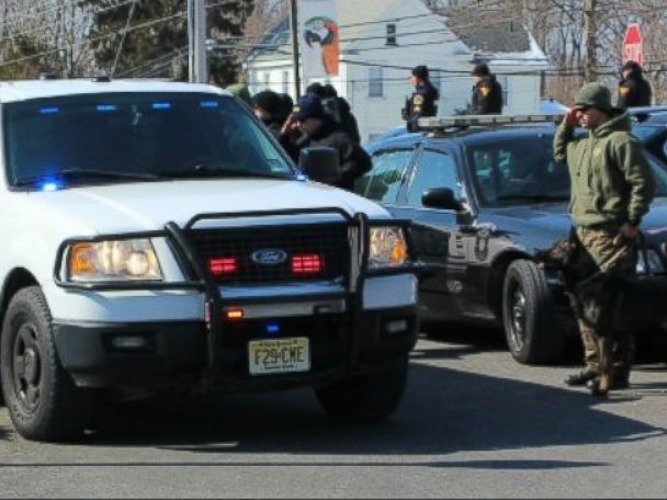 PHOTO: K-9 officers and their partners line the driveway of the Swedesboro Animal Hospital and salute as the small convoy with Mike Franks and Judge arrive.