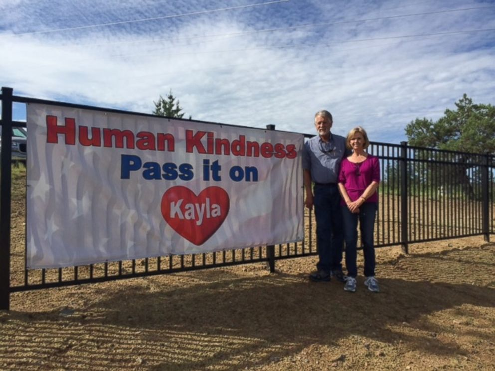 Carl and Marsha Mueller are seen here at the playground named Kaylas Hands in honor of their daughter, Kayla Mueller.