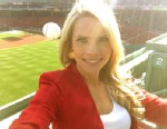 PHOTO: Sports Reporter Kelly Nash almost gets hit by a ball at Fenway Park.