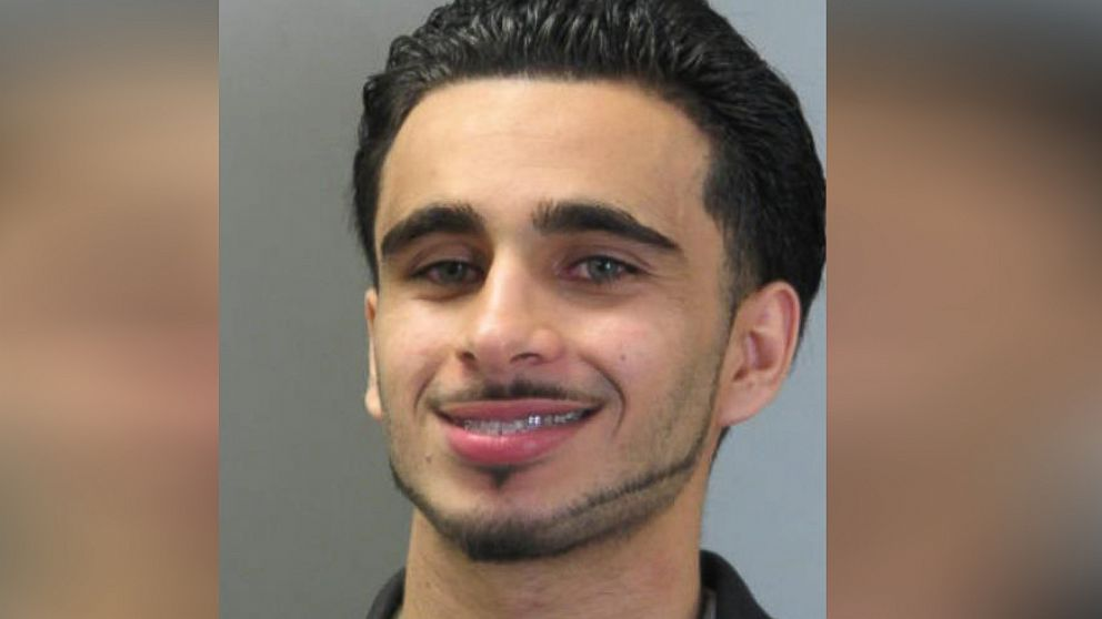 Mohamad Jamal Khweis smiles in a mugshot taken in 2009 in Fairfax County, Virginia.