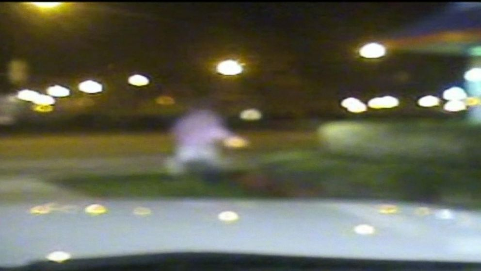 Laquan McDonald runs away from Jason Van Dyke's squad car in this newly released dash cam footage from the Chicago Police Department.