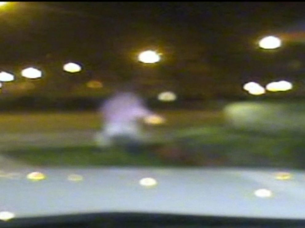 PHOTO: Laquan McDonald runs away from Jason Van Dykes squad car in this newly released dash cam footage from the Chicago Police Department.