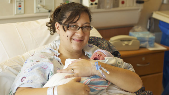 PHOTO: Katie Medley holds her newborn son, Hugo Jackson Medley, who was born July 24, 2012, in University of Colorado Hospital, where father Caleb Medley was being treated for injuries suffered in the Aurora, Colo., theater shooting.