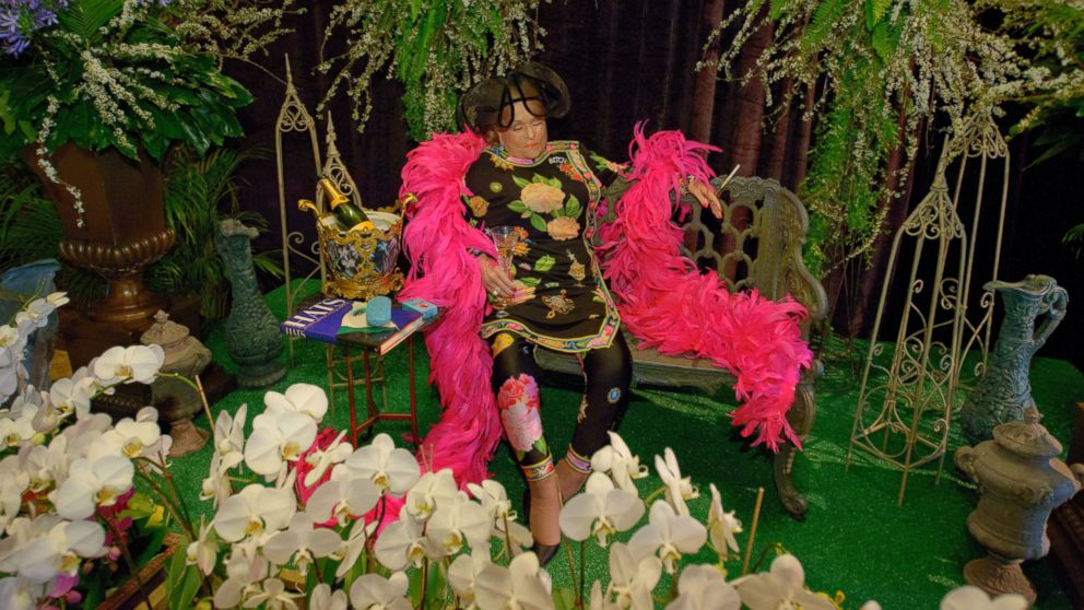 The body of Mickey Easterling, a New Orleans socialite, sits on a bench surrounded by flowers and some of her other favorite things at the Saenger Theatre in New Orleans, La. April 22, 2014.