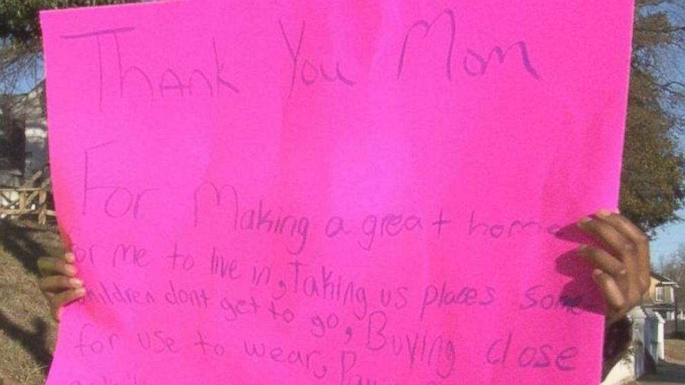 The children's aunt forced them to make these signs to apologize to their frustrated mom.