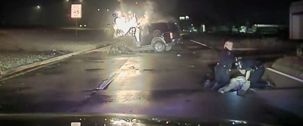 PHOTO: Two police officers in Mesquite, Texas, were able to rescue an unconscious driver from his car after it caught on fire in the early hours of April 19, 2015.