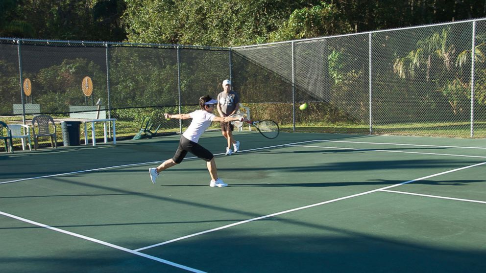 Nalcrest residents playing tennis.