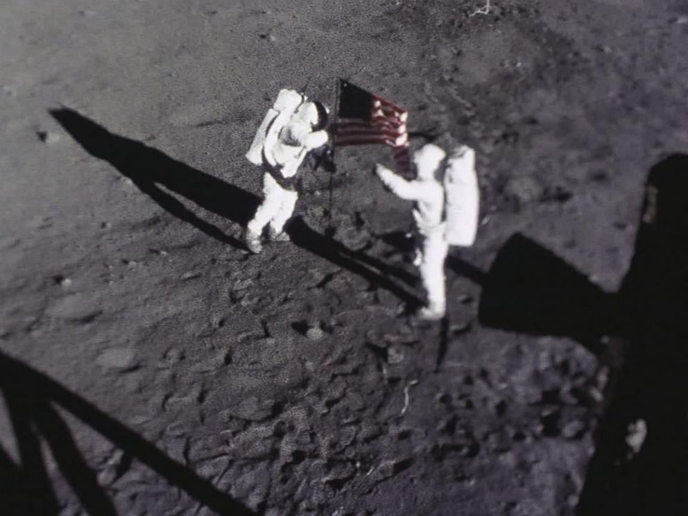 PHOTO: Astronauts Neil Armstrong and Buzz Aldrin place the American flag on the Moon.