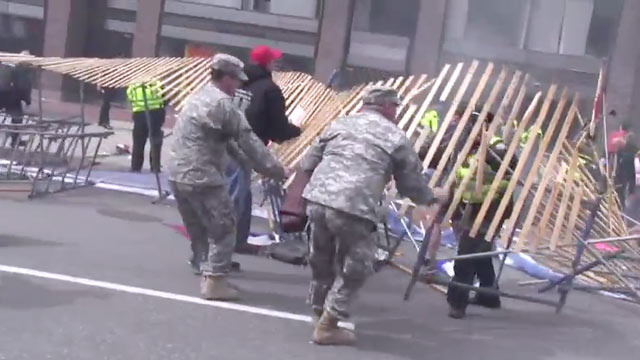 PHOTO: 1st Lt. Stephen Fiola (left) and 1st Sgt. Bernard Madore (right) rushed to help the injured immediately after the explosions near the finish line of the Boston Marathon, April 15, 2013.