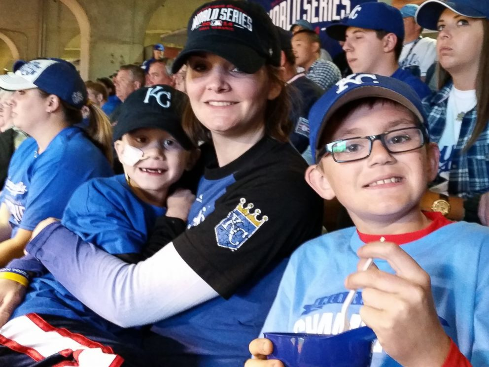 PHOTO: Noah Wilson poses for a photo at the World Series on Oct 21, 2014 with his mom and brother.