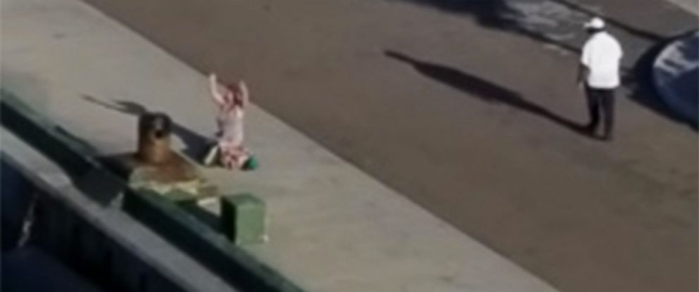 PHOTO: Norwegian Cruise Line passenger watches in horror as the ship sails away from its port in Nassau, Bahamas with her children on board.