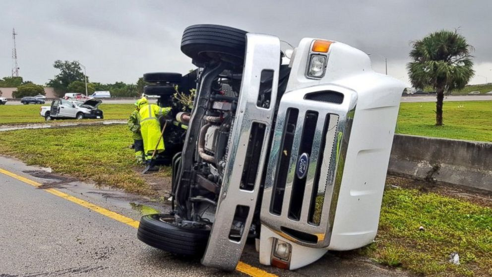 A tractor trailer is pictured after it was overturned by strong winds on Jan. 27, 2016, on the Florida Turnpike near the Coconut Creek Parkway in Broward County, Fla.