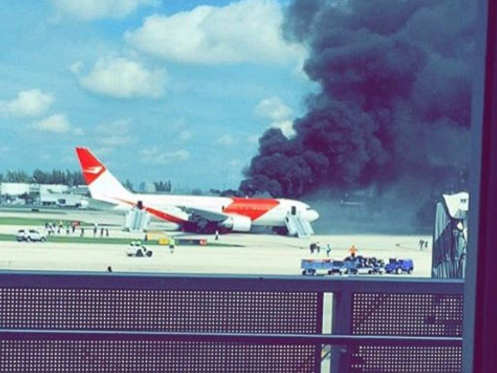 PHOTO: A Dynamic International Airways plane burns on the tarmac at Ft. Lauderdale-Hollywood International Airport on Oct. 29, 2015.