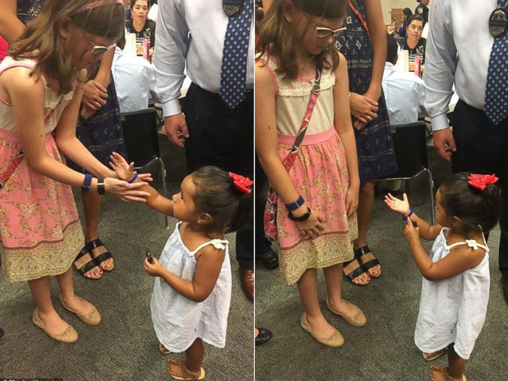 PHOTO: The daughter of Sgt. Michael Smith made a bracelet for the daughter of Officer Patrick Zamarripa and gave it to her at a memorial service for their fathers and the three other Dallas officers who were killed during a protest in Dallas, Texas.