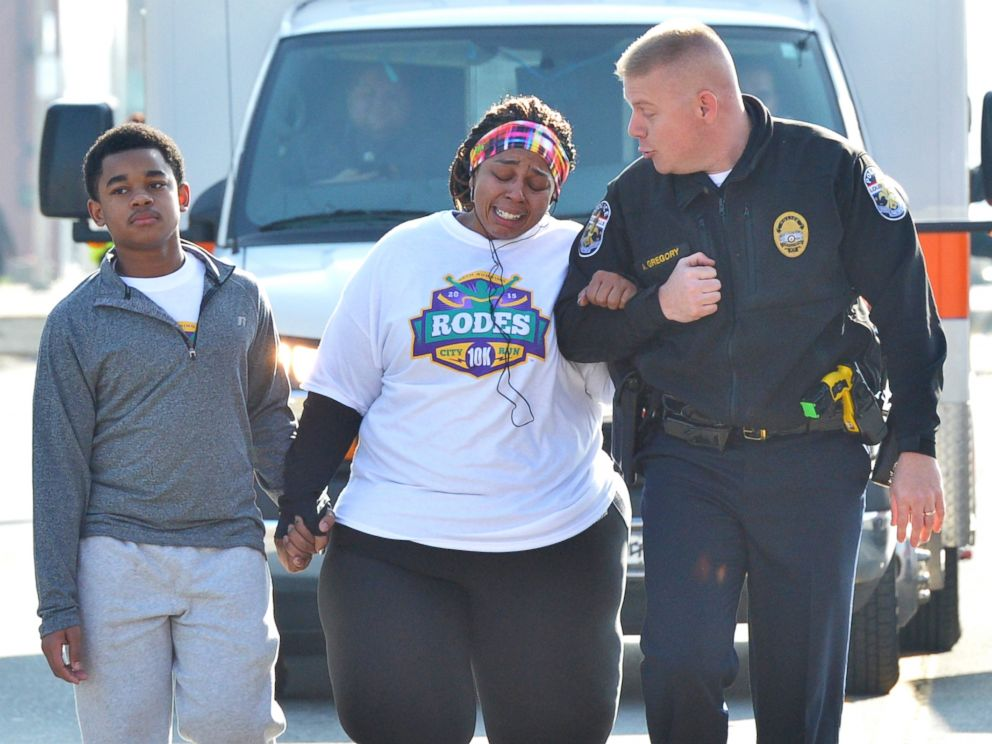 PHOTO: Police Officer Aubrey Gregory walks with Asia Ford as she participates in the Rodes City Run 10K in Louisville, Ky. on March 21, 2015.