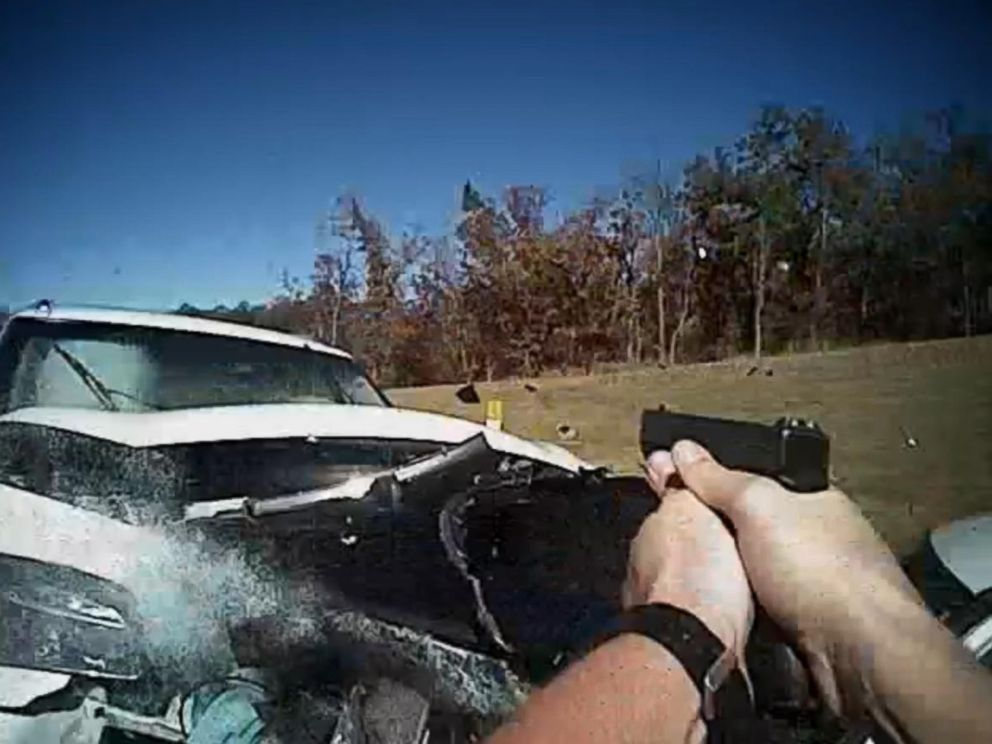 PHOTO: Police video shows Officer Matt Stacy taking aim at a car before it rams his vehicle in Sand Springs, Okla., Nov. 6, 2015.