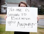 PHOTO: Sexual-abuse victim holding sign