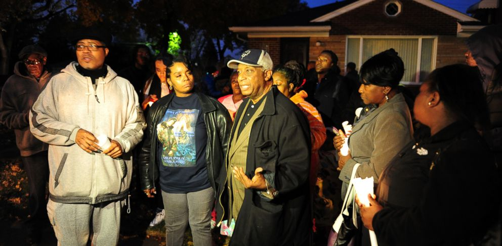 PHOTO: Pastor W. J. Rideout of Detroit Good Jobs Now, Bernita Spinks and Ron Scott of Detroit Coalition Against Police Brutality at the vigil for Renisha McBride in the front of the home of the shooting in Dearborn Heights on Nov. 6, 2013.