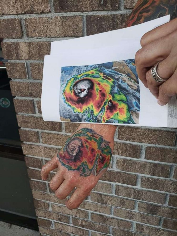 Rex Clark shows off a tattoo he got on his hand of satellite imagery of Hurricane Michael, which destroyed his Panama City home in Oct. 2018.