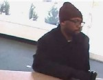 PHOTO: A bank robber has robbed 9 banks around Philadelphia walking in without a disguise seen here on surveillance on Feb. 14, 2013 at a TD bank.