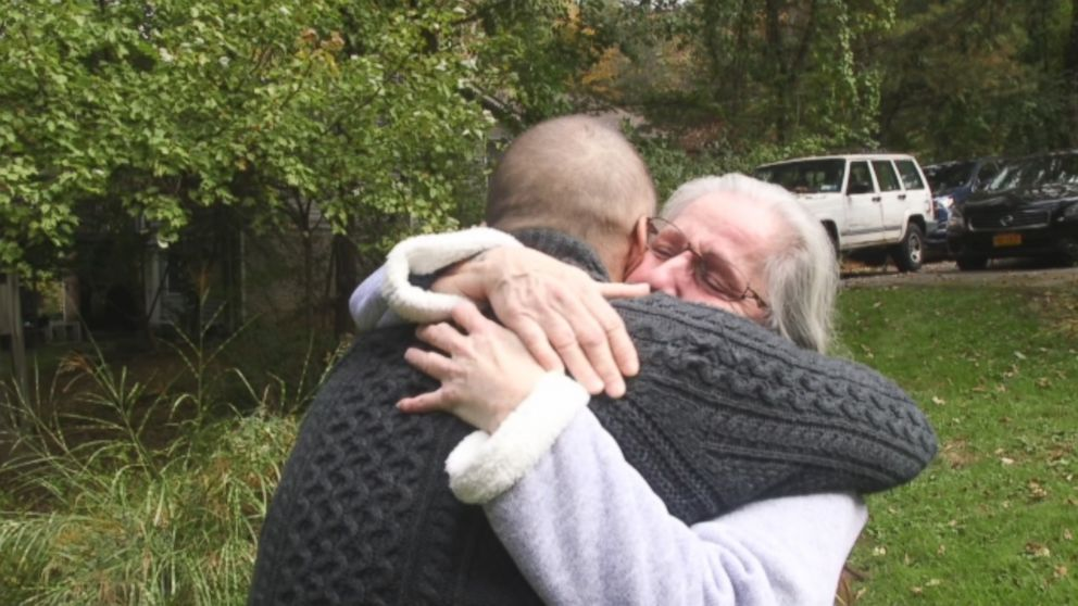 Deborah Garza and Rob Martin embrace after meeting for the first time.