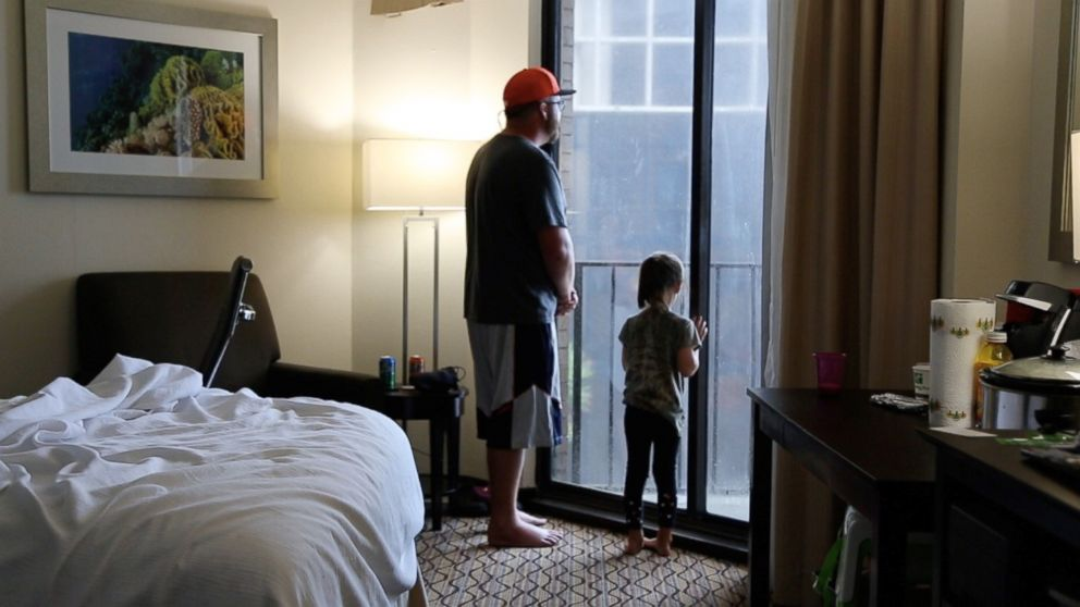 William Weeks and his daughter Anabella at a hotel in Corpus Christi, Texas, on August 25, 2017, after they were forced to evacuate their home due to the arrival of Hurricane Harvey.
