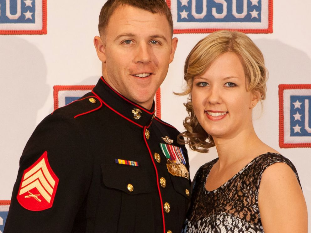 PHOTO: U.S. Marine Corps Sgt. Andrew C. Seif, left, poses for a photo with his wife, Dawn, during the reception before the 2013 USO Gala in Washington, Oct. 25, 2013.
