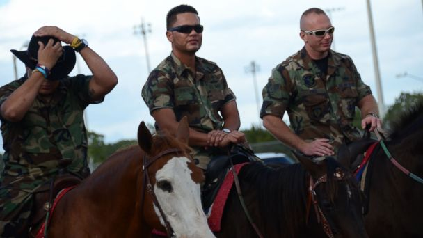 PHOTO: Lito Santos, left, of the US Army is seen in this undated handout photo with Lyndon Ortiz of the US Marine Corps and Chris Schwann, right, of the US Air Force. They were in the arena warming up before they performed in the Silver Spurs Rodeo.