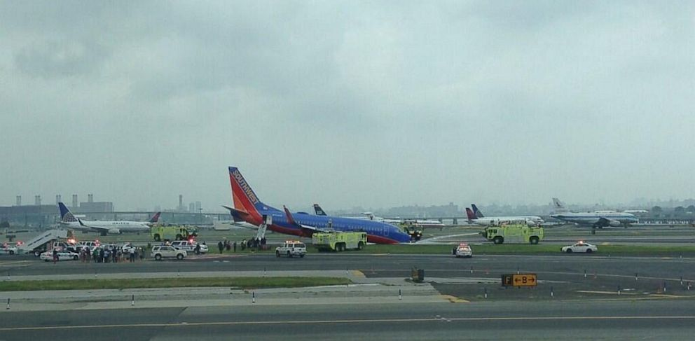 PHOTO: The nose gear of a Southwest plane landing at New Yorks LaGuardia Airport collapsed as the aircraft landed on the runway on July 22, 2013.