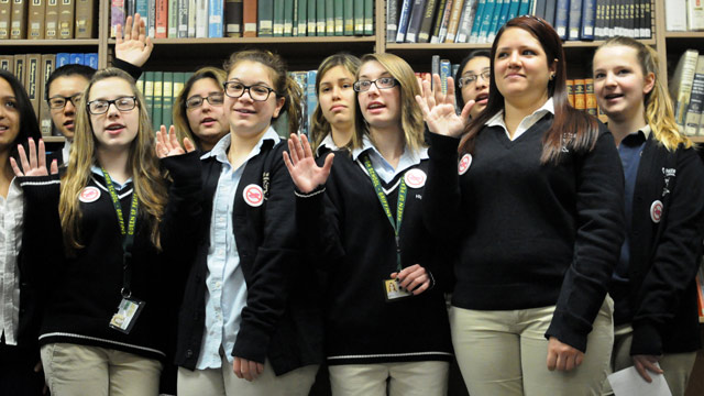 PHOTO: Female students at Queen of Peace High School in North Arlington take a pledge not to swear for the month of February.